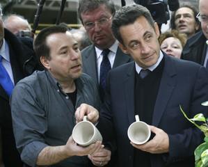 France's UMP political party presidential candidate Nicolas Sarkozy visits a porcelain factory near Vierzon