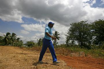Sri Lanka's captain Sangakkara walks towards ground during practice session at Rangiri Dambulla stadium in Dambulla