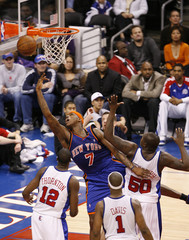 New York Knicks Harrington reaches for a rebound against the Los Angeles Clippers during their NBA basketball game in Los Angeles