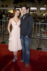 """Actress Jennifer Love Hewitt and Ross McCall pose on the red carpet at the premiere of """"27 Dresses"""" in Los Angeles, California"""