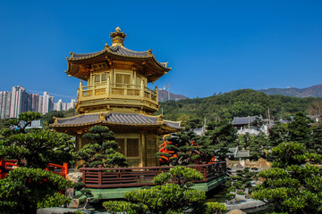 Hong Kong, China, January 30, 2013: Tourists visiting traditional Chinese park in the center of Hong Kong