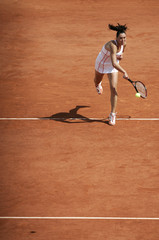 Jelena Jankovic of Serbia serves to Venus Williams of the U.S. during the French Open tennis tournament at Roland Garros in Paris
