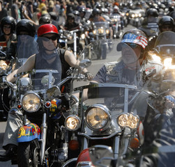 """Bikers cruise along the Ringstrasse during the """"Vienna Harley Days"""" motorcycle parade in Vienna"""