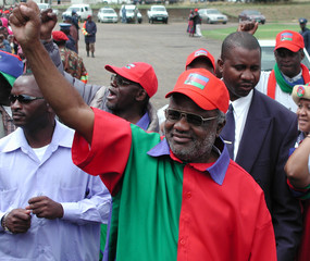 Namibian presidential candidate Pohamba raises clenched fist at closing election campaign rally in.