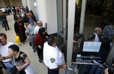 People enter an IndyMac Bank branch at the company's corporate headquarters, after waiting in line for it to open under federal management, in Pasadena