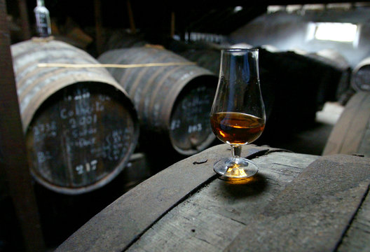 -PHOTO TAKEN 13OCT04- A glass filled with vintage Madeira wine is seen in the storage area of the Ar..