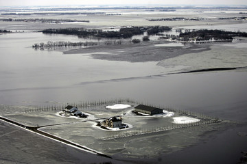 An aerial view shows snow, ice, and water from overland flooding cover the landscape south of Fargo, North Dakota