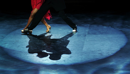 A couple dances during the semi-final round of the Tango Dance World Championship in Buenos Aires