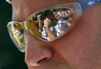 The reflection of clenched arms is seen in the sunglasses  of a competitor during the in 27th Annual White Castle Kingsboro Golden Arm Wrestling Championship in New York