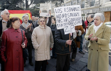People shout slogans against Spanish PM Zapatero during a demonstration in downtown Madrid