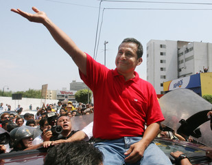Peruvian candidate Ollanta Humala  waves after voting in Lima