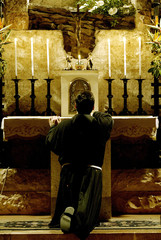 File photograph of Franciscan monk Father Enzo Fortunato praying for peace during a vigil at the tomb of Saint Francis in Assisi