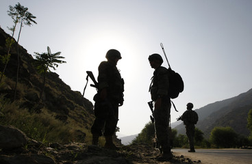 Soldiers of the U.S. Army's Gator Company, 2-12 Infantry, 4th Brigade, and the Afghan National Army patrol a road along the Pesh Valley