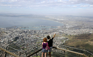 Visitors enjoy the view over the city of Cape Town from the top of Table Mountain in Cape Town