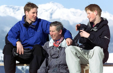 The Prince of Wales, Prince Charles (C) and his sons Prince William (L) and Prince Harry (R) joke du..