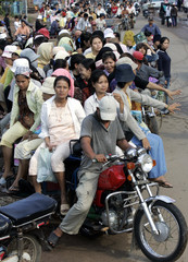 Garment workers ride home after work in Phnom Penh
