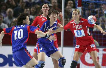 South Korea's Oh and Huh challenge with Norway's Aamodt and Hammerseng for ball in Paris