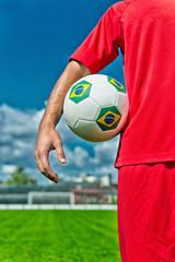 Soccer player holding ball