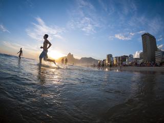 Silhouette running on the shore of Ipanema Beach in Rio de Janeiro, Brazil