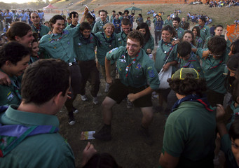 Scouts dance as they attend celebrations for the first century anniversary of scouts foundation at the Circo Massimo in Rome