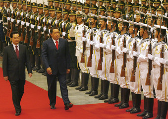China's President Hu and his Venezuelan counterpart Chavez review an honour guard during a welcome ceremony in Beijing