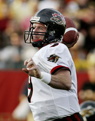 RENEGADES QUARTERBACK CROWLEY THROWS PASS AGAINST TIGER CATS.