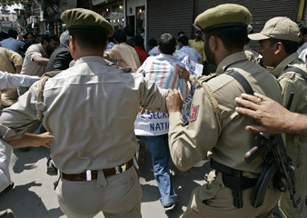 Indian police chase away members of DPM during anti-India protest in Srinagar