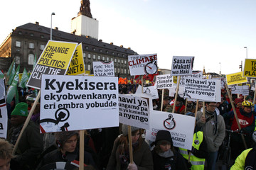 Thousands of demonstrators hold signs as they march to a rally outside the UN Climate Change Conference  in Copenhagen.