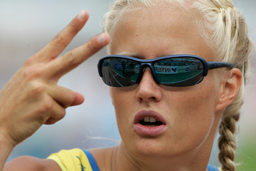 Sweden's Carolina Kluft gestures after competing in her 100 m hurdles heat during the women's heptathlon at the European athletics championships in Gothenburg