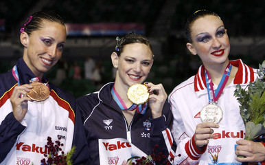 Medalist pose with their medals in the synchronised swimming solo free routine at the World Aquatics Championships in Melbourne