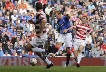 Rangers'  Steven Whittaker shoots and scores against Hamilton during their Scottish Premier League soccer match at Ibrox Stadium in Glasgow