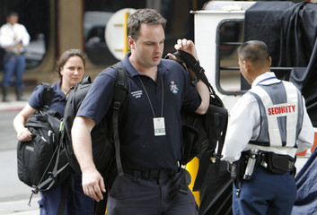 Australian National Police arrive at the site of last week's explosion at an upscale shopping mall in Makati City