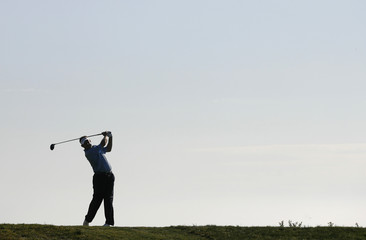Lee Westwood hits from the 17th tee during the fourth round of the U.S. Open golf championship at Torrey Pines in San Diego