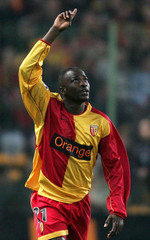 Lens' Utaka celebrates his goal against Bordeaux during their French Ligue 1 soccer match in Lens.