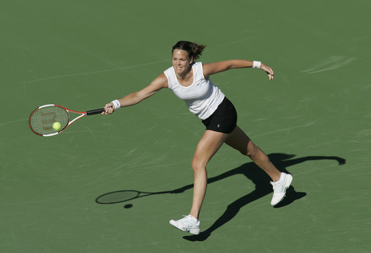 Lindsay Davenport lunges for forehand during workout at Pacific Life Open tennis tournament in Indian Wells