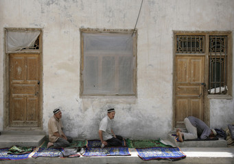 Muslims attend Friday prayers at a Mosque at the former Silk Road city of Hotan