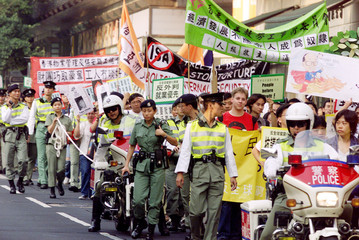 PROTESTERS MARCH DURING AN ANTI-GLOBALISATION DEMONSTRATION IN HONGKONG.