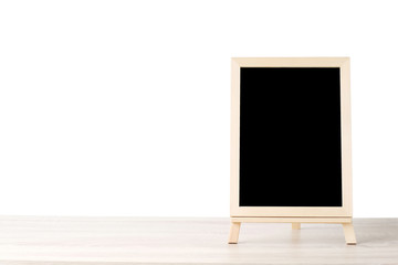 Blank chalkboard standing on wood table isolated on white background, space for text, mock up, product display montage, banner