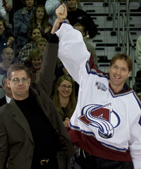 AVALANCHE GOALIE ROY ARM RAISED BY THE LATE TERRY SAWCHUCK'S SON JERRY.
