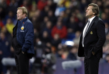Valencia coach Koeman and Real Madrid coach Schuster watch during their Spanish First Division soccer match in Madrid