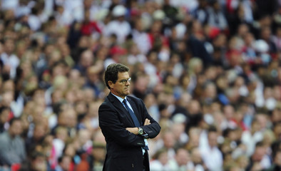 England's coach Fabio Capello watches his team play against Slovenia during their international friendly soccer match at Wembley Stadium in London