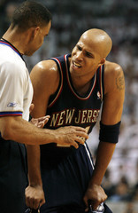 New Jersey Nets Jefferson complains during game against Miami Heat in Florida