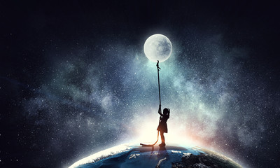 Kid girl catching moon Wall mural