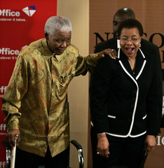 Former South African President Nelson Mandela leans on his wife Graca Macel during the launch of postal stamps in Houghton
