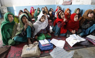 Afghan girls attend a lesson at the secondary school in Sarkani village