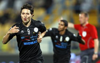 Al-Sadd's Mauro Zarate celebrates after scoring against Al-Gharafa during their Qatar Championship soccer match in Doha