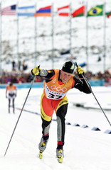 SPANIARD MUEHLEGG FINISHES OLYMPIC 50 KM CROSS COUNTRY CLASSICAL RACE.