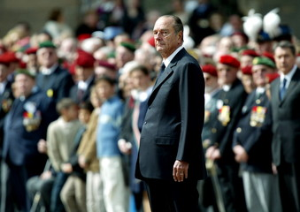 French President Jacques Chirac attends a ceremony at the Invalides in Paris, May 7, 2004. Chirac pa..