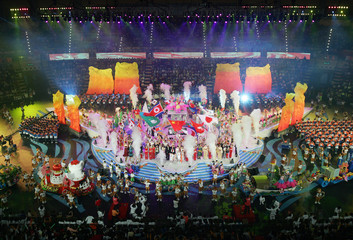 Performers dance on stage during closing ceremony of East Asian Games in Macau