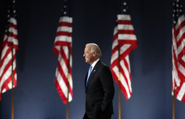 U.S. Vice President-elect Biden smiles as he arrives onto stage in Chicago